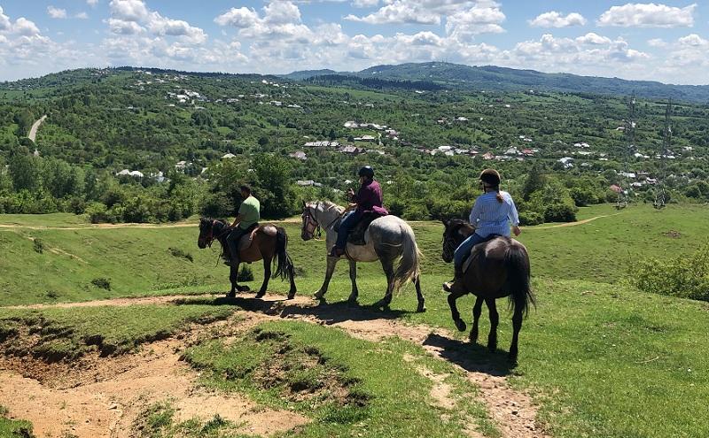 Tourists horseback riding in the Wild Romania.