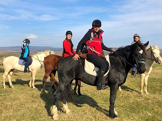on top of a Transylvanian hill during horseback riding tour