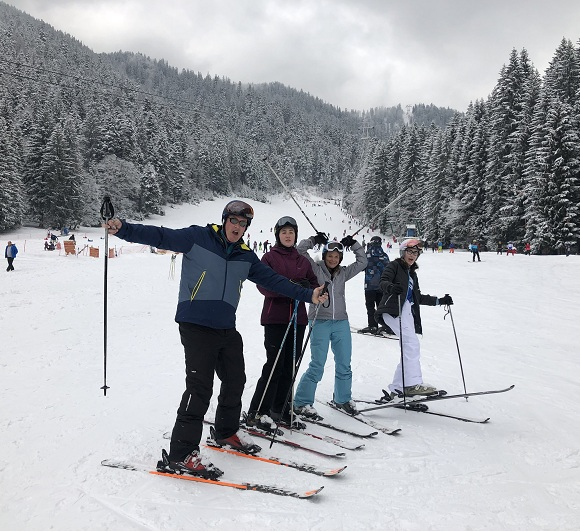 family having fun during ski lessons in Poiana Brasov